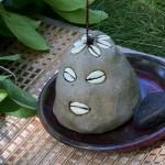 Eleggua in the traditional hand-molded cement head form in Santeria Lukumí (This is Eshu Alawana)