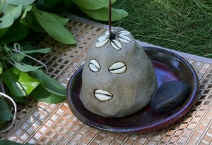 Eleggua in the traditional hand-molded cement head form in Santeria Lukum (This is Eshu Alawana)