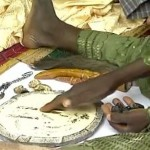 A Babalawo performs Ifá divination using the Ikín and Opón Ifá