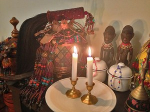 Two candles offered to the ibeji at the Santeria Church of the Orishas.