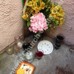 The Lucumí Ancestral Shrine at our church with offerings of flowers, food, drinks and cigar
